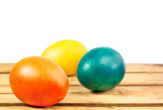 Colorful eggs. Easter eggs on wooden floor over white background Stock Image