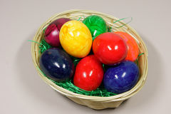 Colorful eggs in a basket. With green grass Royalty Free Stock Photos