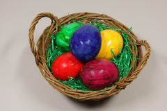Colorful eggs in a basket. With green grass stock photo