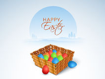 Colorful eggs basket for Happy Easter celebration. Happy Easter celebration with glossy basket full of colorful eggs, can be used as greeting or invitation card Stock Images