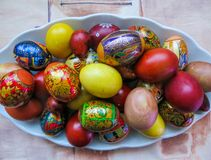 Colorful eggs, boiled and painted by hand, cooked for Easter royalty free stock images