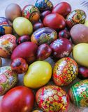 Colorful eggs, boiled and painted by hand, cooked for Easter royalty free stock photos