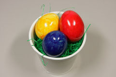 Colorful eggs in a bowl. With green grass Stock Photo