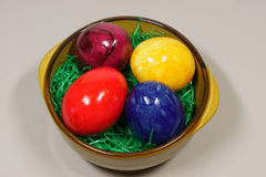 Colorful eggs in a bowl. With green grass Royalty Free Stock Photography
