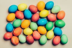 Colorful eggs on a creamy background. Stock Photo