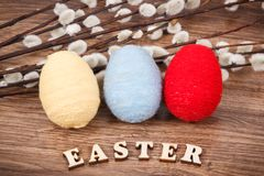 Colorful eggs and Easter catkins as festive decoration Stock Photos