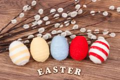 Colorful eggs and Easter catkins as festive decoration Stock Photo