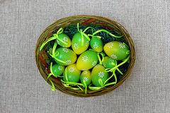 Colorful eggs for holiday Easter. Decorative colorful eggs for Easter in a basket Royalty Free Stock Photos