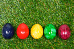 Colorful eggs lie on a synthetic grass. Five colorful eggs lie on a synthetic grass Royalty Free Stock Image