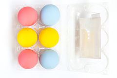 Colorful eggs in plastic box Stock Photography