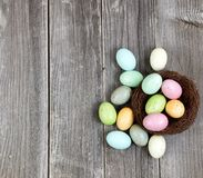 Colorful eggs on vintage wooden planks for Easter Background Stock Image