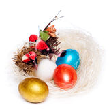 Colorful eggs in a wicker Royalty Free Stock Image