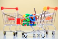 Colorful elastic hair bands in shopping trolley Royalty Free Stock Photos