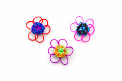 Colorful elastic rainbow loom bands flower shaped. Royalty Free Stock Photo