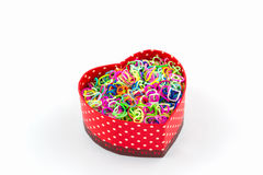 Colorful elastic rainbow loom bands in gift box shaped heart. Colorful elastic rainbow loom bands in gift box shaped heart on white background Royalty Free Stock Image