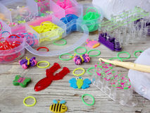 Colorful of elastic rainbow loom bands kit. On wooden background royalty free stock photography