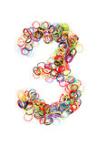 Colorful elastic rubber bands shape Number three stock image