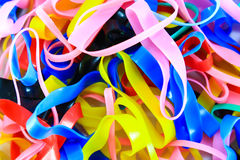 Colorful elastic rubber bands on white texture background Stock Photography