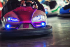 Colorful electric bumper car in autodrom in the fairground attra. Ctions at amusement park Stock Images