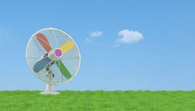 Colorful electric fan on grass Royalty Free Stock Photos