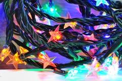 Colorful electric garland Stock Photos
