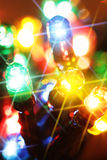 Colorful electric light bulbs. Close-up with glare Royalty Free Stock Image