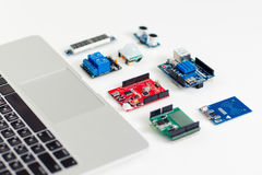 Colorful electronic components near laptop Stock Photos