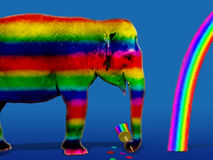 Colorful elephant. Funny colorful elephant drawing a rainbow Stock Photography
