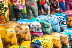 Colorful elephant parade miniatures stock images