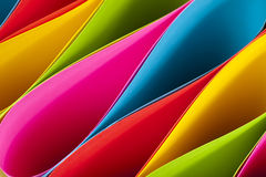 Colorful Ellipses. Colorful card stock in unique elliptical shapes with shadow effect and selective focus royalty free stock image