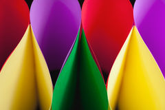 Colorful Ellipses. Colorful paper in elliptical shapes with shadows on a black background stock image