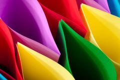 Colorful Ellipses. Colorful paper in elliptical shapes with shadows on a black background stock photography