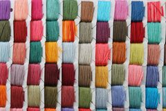 Colorful Embroidery Thread. Group of Embroidery thread cards lined up in a grid showing random colors Royalty Free Stock Image