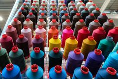 Colorful embroidery thread spool using in garment industry, row. Of multicolored yarn rolls, sewing material selling in the market royalty free stock photos