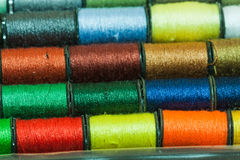 Colorful embroidery threads. Arranged in rows Stock Photo