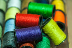 Colorful embroidery threads. Collection of colorful embroidery thread bobbins using for sewing Royalty Free Stock Photography