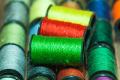 Colorful embroidery threads. Collection of colorful embroidery thread bobbins using for sewing Stock Photo