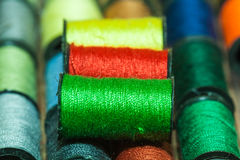 Colorful embroidery threads. Colorful embroidery thread bobbins arranged in rows Stock Photography