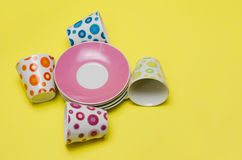 Colorful empty cups and stacked saucers Royalty Free Stock Images