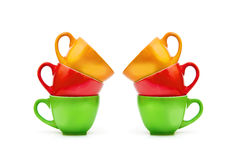 Colorful empty mugs over white background Stock Image