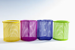 Colorful empty pen and pencil holders. Royalty Free Stock Photos