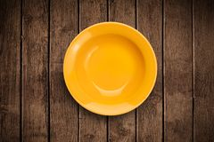 Colorful empty plate on grungy background table Royalty Free Stock Image