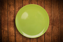 Colorful empty plate on grungy background table Royalty Free Stock Images