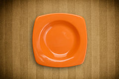 Colorful empty plate on grungy background table Stock Images