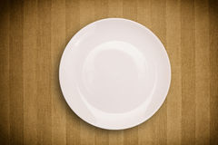 Colorful empty plate on grungy background table Stock Photos
