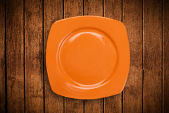 Colorful empty plate on grungy background table Royalty Free Stock Photography