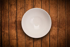 Colorful empty plate on grungy background table Stock Photo