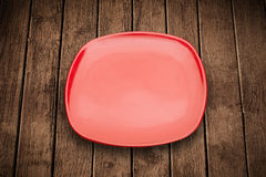 Colorful empty plate on grungy background table Stock Image