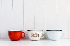 Colorful enameled mugs Stock Photos