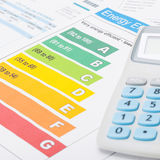 Colorful energy efficiency chart and calculator - close up shot Stock Photo